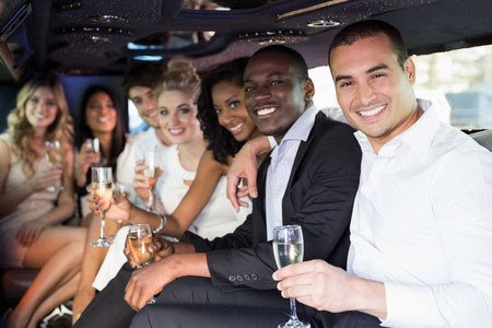 Image of a group of happy people in a limo provided by Neumann Enterprises in Sacramento, CA